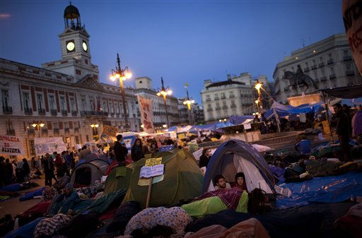 Demonstrators in tents spend the night at Sol square during a protest in Madrid, Friday May 20, 2011. Spanish university students and youth groups are protesting against a youth unemployment rate of 40 percent and austerity measures taken to end Spain&#39;s debt crisis. The biggest banner in Spanish reads &#34;Change&#34;. &#40;AP Photo&#47;Emilio Morenatti&#41; <span class=meta>(AP Photo&#47; Emilio Morenatti)</span>