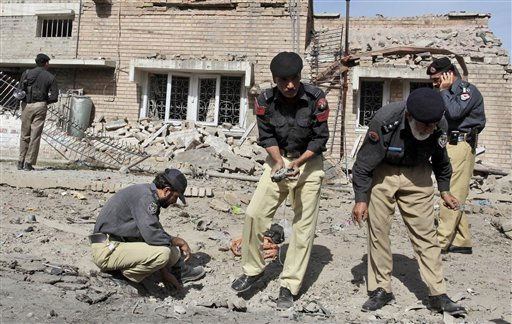 "<div class=""meta ""><span class=""caption-text "">Pakistani police officers collect evidence from the site of a bomb explosion in Peshawar, Pakistan, Friday, May 20, 2011. A Taliban suicide bomber rammed his motorbike into an armored vehicle taking American officials to the U.S consulate in northwest Pakistan on Friday, in a strike the militants said was in revenge for the raid that killed Osama bin Laden.  Two Americans suffered minor injuries, but one Pakistani passer-by was killed and at least 10 others were wounded in the attack in the city of Peshawar, officials said. The strike was the first on Westerners since the May 2 raid by American commandos on bin Laden's hideout in an army town around three hours from Peshawar. (AP Photo/Mohammad Sajjad) (AP Photo/ Mohammad Sajjad)</span></div>"