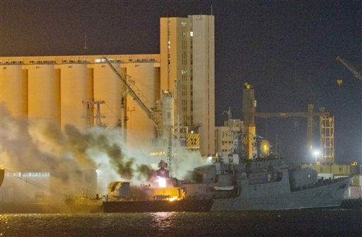 **ADDS INFORMATION IN SHIP &amp; EXPANDS CAPTION**Smoke and flames pour from the Libyan Navy frigate Al Ghardabia, after it was hit during an airstrike by Tornado bombers of Britain&#39;s Royal Force on the port area of Tripoli, in the early hours of Friday May 20, 2011. NATO confirmed that its warplanes targeted the vessels and accused Libya of using its ships in the escalating conflict, including attempts to mine the harbor in Misrata. Rebels trying to end the nearly 40-year rule of Libyan leader Moammar Gadhafi have been struggling to hold the Western city of Misrata against repeated attacks by forces loyal to Gadhafi&#40;AP Photo&#47;Darko Bandic&#41; <span class=meta>(AP Photo&#47; Darko Bandic)</span>