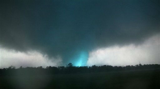 This frame grab from video shows lightning inside a massive tornado on Sunday, May 22, 2011, outside Joplin, Mo.  The tornado tore a 6-mile path across southwestern Missouri killing at least 89 people as it slammed into the city of Joplin, ripping into a hospital, crushing cars like soda cans and leaving a forest of splintered tree trunks behind where entire neighborhoods once stood.  &#40;AP Photo&#47;tornadovideo.net&#41; <span class=meta>(AP Photo&#47; SS JHC**NY**)</span>