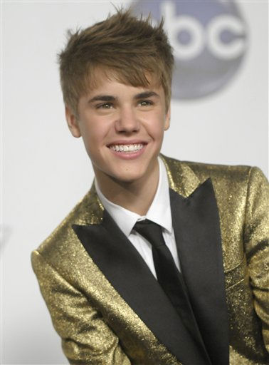 "<div class=""meta ""><span class=""caption-text "">Singer Justin Bieber poses in the press room at the 2011 Billboard Music Awards in Las Vegas on Sunday, May 22, 2011. (AP Photo/Dan Steinberg) (AP Photo/ Dan Steinberg)</span></div>"