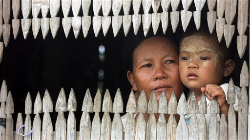 In this photo taken Sunday, May 22, 2011, a woman and a child sit by a window at their house in Nyaung Tone, about 60 miles southwest of Yangon, Myanmar. &#40;AP Photo&#47;Khin Maung Win&#41; <span class=meta>(AP Photo&#47; Khin Maung Win)</span>