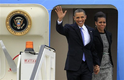 U.S. President Barack Obama waves as he and first lady Michelle Obama disembark from Air Force One as they arrive at Dublin Airport to begin a 24-hour visit to the Republic of Ireland, in Dublin, Monday, May 23, 2011.  Ireland has always offered warm welcomes to U.S. presidents since John F. Kennedy became the first to visit in 1963. More than 40 million Americans have Irish ancestors. The two countries today enjoy exceptional ties of culture and commerce, a crucial relationship for Ireland because of its current battle to avoid national bankruptcy.  &#40;AP Photo&#47;Matt Dunham&#41; <span class=meta>(AP Photo&#47; Matt Dunham)</span>