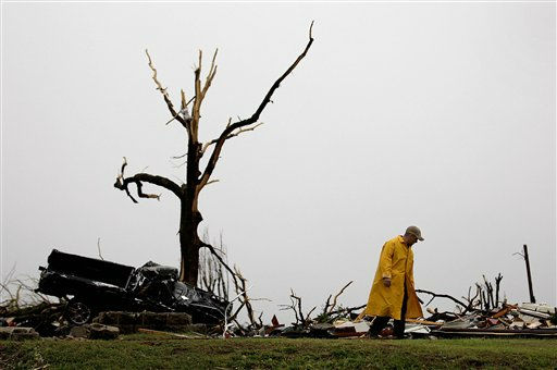 A firefighter searches a home Monday, May 23, 2011, that was destroyed by a tornado in Joplin, Mo. A large tornado moved through much of the city Sunday, damaging a hospital and hundreds of homes and businesses and killing at least 89 people. &#40;AP Photo&#47;Charlie Riedel&#41; <span class=meta>(AP Photo&#47; Charlie Riedel)</span>