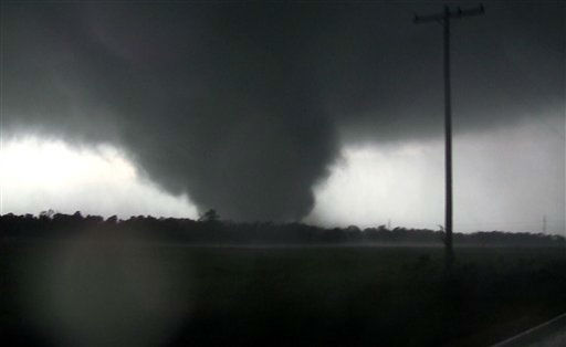 This frame grab from video shows a massive tornado on Sunday, May 22, 2011, outside Joplin, Mo.  The tornado tore a 6-mile path across southwestern Missouri killing at least 89 people as it slammed into the city of Joplin, ripping into a hospital, crushing cars like soda cans and leaving a forest of splintered tree trunks behind where entire neighborhoods once stood.  &#40;AP Photo&#47;tornadovideo.net&#41; <span class=meta>(AP Photo&#47; SS JHC**NY**)</span>