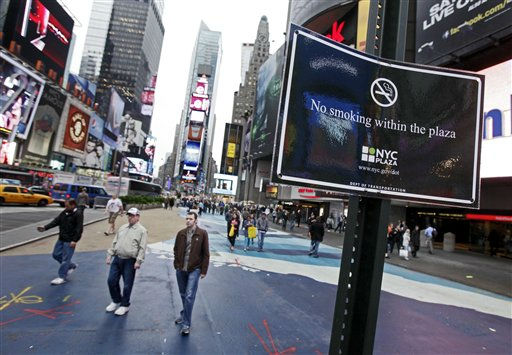 A sign posted in New York&#39;s Times Square warns of the city&#39;s new smoking ban, Monday, May 23, 2011. Starting Monday, a new law went into effect banning smoking in New York&#39;s urban parks and other public places, enforced with a &#36;50 fine. &#40;AP Photo&#47;Richard Drew&#41; <span class=meta>(AP Photo&#47; Richard Drew)</span>
