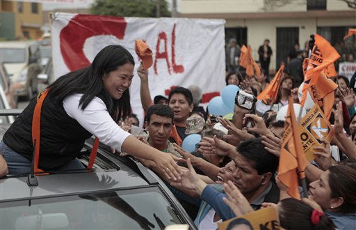"<div class=""meta ""><span class=""caption-text "">Peru's presidential candidate Keiko Fujimori, of the political party Fuerza 2011, shakes hands with supporters during a campaign rally in Ancon, Peru, Tuesday May 31, 2011. Keiko Fujimori, daughter of former Peru's President Alberto Fujimori, will face Ollanta Humala in a presidential runoff June 5. (AP Photo/Esteban Felix) (AP Photo/ Esteban Felix)</span></div>"