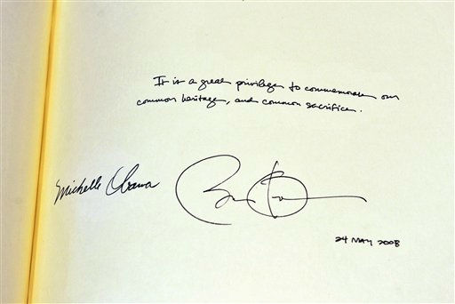 A message from US President Barack Obama and his wife, first lady Michelle Obama, apparently signed by the President with the wrong date of 2008 in the distinguished visitors&#39; book during a tour of Westminster Abbey, in central London, as part of his state visit to the United Kingdom, Tuesday May 24, 2011. &#40;AP Photo&#47;John Stillwell, Pool&#41; <span class=meta>(AP Photo&#47; John Stillwell)</span>