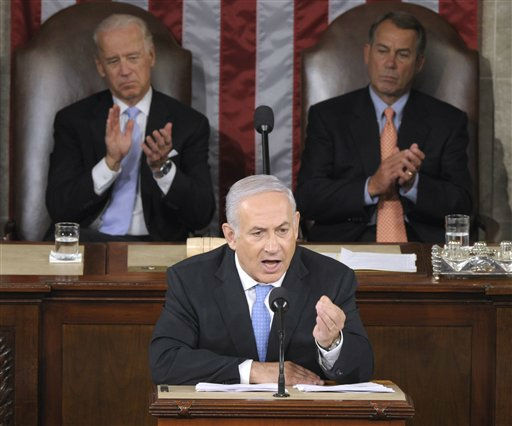 Israeli Prime Minister Benjamin Netanyahu addresses a joint meeting of Congress on Capitol Hill in Washington, Tuesday, May 24, 2011. Vice President Joe Biden, left, and House Speaker John Boehner of Ohio, right, listen. &#40;AP Photo&#47;Susan Walsh&#41; <span class=meta>(AP Photo&#47; Susan Walsh)</span>