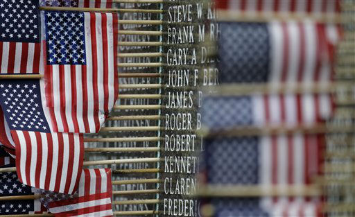 Some of the names of soldiers from Washington state who died in the Vietnam War are shown with flags next to them on a memorial at the Capitol in Olympia, Wash., Tuesday, May 24, 2011. Memorial Day is Monday, May 30.&#40;AP Photo&#47;Ted S. Warren&#41; <span class=meta>(AP Photo&#47; Ted S. Warren)</span>