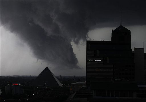 A line of severe storms cross the Mississippi River in Memphis, Tenn., passing by the Memphis Pyramid on Wednesday, May 25, 2011. The dark formation was reported a few minutes earlier as a tornado in West Memphis, Ark.    &#40;AP Photo&#47;Lance Murphey&#41; <span class=meta>(AP Photo&#47; Lance Murphey)</span>