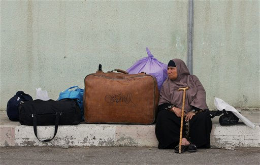 A Palestinian woman waits near her belongings before crossing into Egypt through the Rafah border crossing, southern Gaza Strip, Thursday, May 26, 2011. Egypt&#39;s decision to end its blockade of Gaza by opening the only crossing to the Hamas-ruled Palestinian territory this weekend could ease the isolation of 1.4 million Palestinians there. &#40;AP Photo&#47;Eyad Baba&#41; <span class=meta>(AP Photo&#47; Eyad Baba)</span>