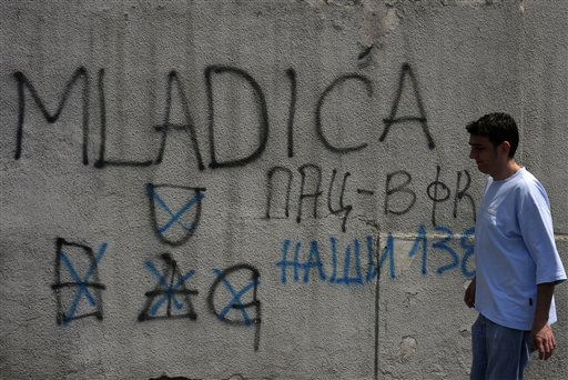 A man passes by a graffiti reading &#34;Mladic to the Hague&#34;, in a suburb of Belgrade, Serbia, Thursday, May 26, 2011. A man believed to be Gen. Ratko Mladic, Europe&#39;s most wanted war crimes fugitive, has been arrested in Serbia, news media reported on Thursday. &#40;AP Photo&#47; Marko Drobnjakovic&#41; <span class=meta>(AP Photo&#47; Marko Drobnjakovic)</span>