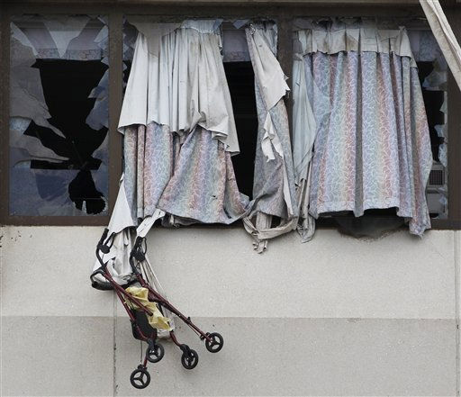 A walker hangs out a window blown out by a tornado at St. John&#39;s Regional Health Center on Thursday, May 26, 2011, in Joplin, Mo. A tornado tore through much of the city Sunday, wiping out neighborhoods and killing at least 125 people. &#40;AP Photo&#47;Mark Humphrey&#41; <span class=meta>(AP Photo&#47; Mark Humphrey)</span>