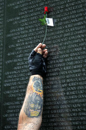 Dave Wetiner holds a rose over thename of his friend Alfred F. Hallat at the wall of the Vietnam Veterans Memorial in Washington on Sunday,  May 29,  2011. Motorcyclists are in Washington for the traditional annual Rolling Thunder events during the Memorial Day weekend.&#40;AP Photo&#47;Jose Luis Magana&#41; <span class=meta>(AP Photo&#47; Jose Luis Magana)</span>