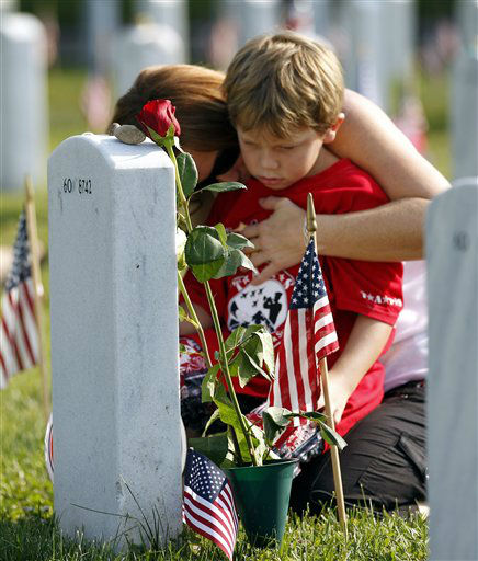 "<div class=""meta ""><span class=""caption-text "">Trisha Lawton and her son Caden prays over the grave of husband and father, Marine Capt. Garrett T. Lawton on Memorial Day Monday, May 30, 2011, in Arlington National Cemetery's Section 60, which was visited by President Barack Obama Monday.  Lawton, 31, of of Charleston, W.Va., in 2008 during Operation Enduring Freedom. (AP Photo/Jose Luis Magana) (AP Photo/ Jose Luis Magana)</span></div>"