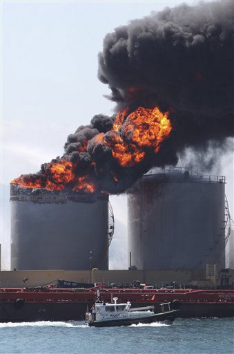Flames and smoke billow from an oil tank in the docks at Gibraltar, Tuesday May 31, 2011.  The cause of the explosion was not immediately known but two people were reported injured. &#40;AP Photo&#47;Alicia Jimenez&#41; <span class=meta>(AP Photo&#47; Alicia Jimenez)</span>