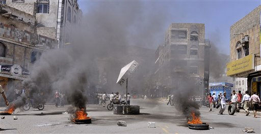 Anti-government protestors block the road with rocks and burning tyres during clashes with Yemeni security forces in Taiz, Yemen, Tuesday, May 31, 2011. Heavy fighting resumed Tuesday in Yemen&#39;s capital between government troops and followers of the country&#39;s most powerful tribal leader, ending a brief cease-fire and again raising the prospect that Yemen&#39;s political crisis could veer into civil war.&#40;AP Photo&#47;Yemen Lens&#41; <span class=meta>(AP Photo&#47; Yemen Lens)</span>