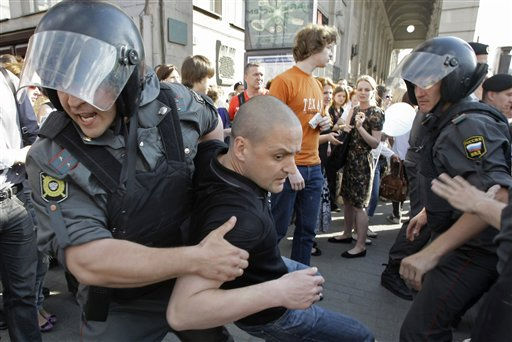 Russian police officers detain Russia&#39;s opposition leader Sergei Udaltsov during an unsanctioned rally  in Moscow, Russia, Tuesday, May 31, 2011. Police in Moscow detained several dozen demonstrators at an unauthorized rally. Russian opposition figures call for protest actions at the end of every month with 31 days. The number corresponds with Article 31 of the Russian Constitution, which guarantees freedom of assembly.  &#40;AP Photo&#47;Misha Japaridze&#41; <span class=meta>(AP Photo&#47; Misha Japaridze)</span>