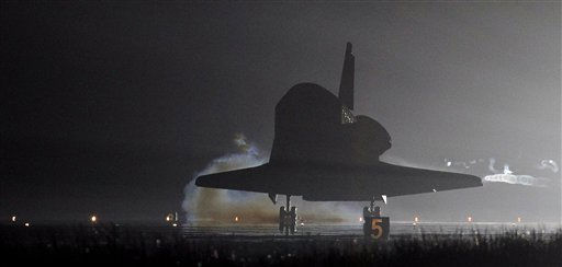 The space shuttle Endeavour touches down on runway 15 after completing her final flight at the Kennedy Space Center in Cape Canaveral, Fla., Wednesday, June 1, 2011. Endeavour , and her crew of six astronauts, wrapped up a 16 day mission to the international space station. &#40;AP Photo&#47;John Raoux&#41; <span class=meta>(AP Photo&#47; John Raoux)</span>