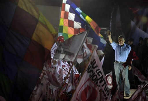 Peru&#39;s presidential candidate Ollanta Humala, of the Gana Peru party, waves to supporters during a campaign rally in Cuzco, Peru, Wednesday, June 1, 2011. Humala will face Keiko Fujimori, daughter of former Peru&#39;s President Alberto Fujimori, in a presidential runoff June 5. &#40;AP Photo&#47;Esteban Felix&#41; <span class=meta>(AP Photo&#47; Esteban Felix)</span>