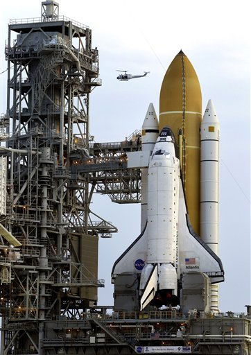 A NASA helicopter flies near the space shuttle Atlantis as she sits on the launch pad just after sunrise Wednesday, June 1, 2011 in Cape Canaveral, Fla. Atlantis, and her crew of four astronauts, is planned to liftoff no earlier than July 8, 2011. &#40;AP Photo&#47;Chris O&#39;Meara&#41; <span class=meta>(AP Photo&#47; Chris O&#39;Meara)</span>