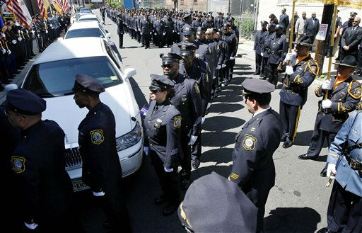 "<div class=""meta ""><span class=""caption-text "">Police officers file into the church Thursday, June 2, 2011, in Newark, N.J., for the funeral of William Johnson, the off-duty Newark police officer, who was killed in a drive-by shooting last Thursday. Johnson was standing at the counter of a fast-food restaurant in Newark waiting for a slice of pizza when he was shot along with two other people.   (AP Photo/Mel Evans) (AP Photo/ Mel Evans)</span></div>"