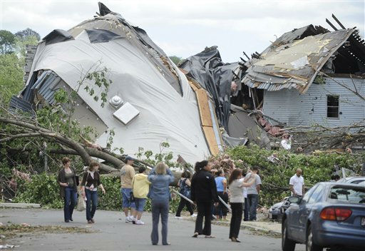People photograph and look at storm damage a day after a tornado in Springfield, Mass., Thursday, June 2, 2011. Massachusetts public health officials say about 200 people have sought treatment for a variety of storm-related injuries, and a Springfield regional trauma center says at least three have injuries so severe they may need long-term rehabilitation. &#40;AP Photo&#47;Jessica Hill&#41; <span class=meta>(AP Photo&#47; Jessica Hill)</span>