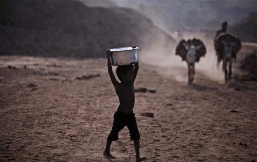 A Pakistani boy walks toward a water point to collect water for his family, on the outskirts of Islamabad, Pakistan, Thursday, June 2, 2011. The U.S. should hold back much of its &#36;7.5 billion aid package to Pakistan until it reforms dysfunctional policies related to energy, taxes and other areas, according to a new report that criticizes the American aid program&#39;s focus in a country beset by corruption, poverty and militancy. &#40;AP Photo&#47;Muhammed Muheisen&#41; <span class=meta>(AP Photo&#47; Muhammed Muheisen)</span>