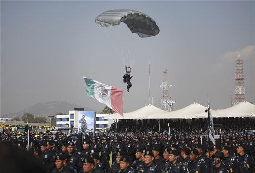 A federal police officer lands with a parachute during a ceremony to designate June 2  Federal Police Day in Mexico City, Thursday, June 2, 2011. &#40;AP Photo&#47;Alexandre Meneghini&#41; <span class=meta>(AP Photo&#47; Alexandre Meneghini)</span>