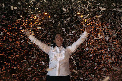 "<div class=""meta ""><span class=""caption-text "">Under pouring confetti, Peru's presidential candidate Keiko Fujimori, of the political party Fuerza 2011, waves to supporters during her closing campaign rally in Lima, Peru, Thursday June 2, 2011. Keiko, daughter of former Peru's President Alberto Fujimori will face Ollanta Humala, of the Gana Peru party, in a presidential runoff June 5. (AP Photo/Esteban Felix) (AP Photo/ Esteban Felix)</span></div>"