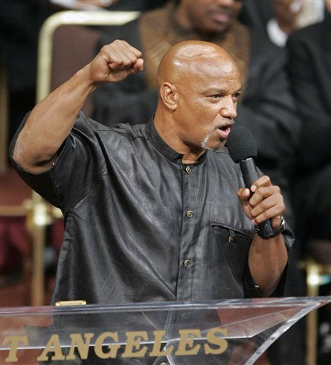 In this April 6, 2005 file photo, Elmer &#34;Geronimo&#34; Pratt speaks during funeral services for attorney Johnnie L. Cochran Jr. at the West Angeles Cathedral in Los Angeles. Cochran in 1997 won freedom for Pratt, a former Black Panther who spent 27 years in prison for a murder he didn&#39;t commit. Pratt, a former Black Panther Party leader who spent 27 years in prison on a murder conviction that was later overturned, died Thursday June 2, 2011 according to attorney Stuart Hanlon. He was 63.  &#40;AP Photo&#47;Damian Dovarganes, File&#41; <span class=meta>(AP Photo&#47; DAMIAN DOVARGANES)</span>