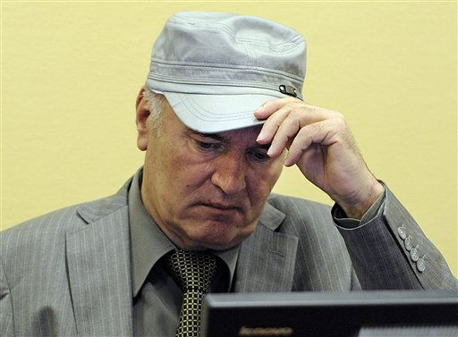 Former Bosnian Serb Gen. Ratko Mladic removes his hat in the court room during his initial appearance at the U.N.&#39;s Yugoslav war crimes tribunal in The Hague, Netherlands, Friday, June 3, 2011. Mladic told a United Nations war crimes court Friday he is &#34;a gravely ill man&#34; as he was arraigned on an 11-count indictment charging him with orchestrating the worst atrocities of a war that claimed 100,000 lives. &#40;AP Photo&#47;Martin Meissner, Pool&#41; <span class=meta>(AP Photo&#47; Martin Meissner)</span>