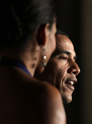 President Barack Obama speaks at the Pritzker Architecture Prize event as first lady Michelle Obama stands left at Andrew Mellon Auditorium, Thursday, June 2, 2011, in Washington. &#40;AP Photo&#47;Carolyn Kaster&#41; <span class=meta>(AP Photo&#47; Carolyn Kaster)</span>