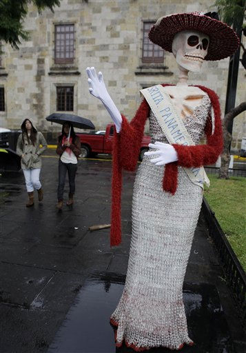 A traditional Mexican Catrina wearing a sash that reads in Spanish &#34;Miss Pan American&#34; stands on display in a park in Guadalajara, Mexico, Thursday Oct. 13, 2011. The 2011 Guadalajara Pan American games are scheduled to begin on Oct. 14. &#40;AP Photo&#47;Javier Galeano&#41; <span class=meta>(AP Photo&#47; Javier Galeano)</span>