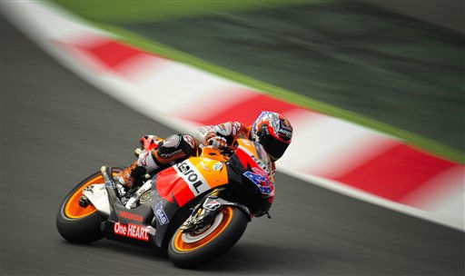 MotoGP rider Casey Stoner, from Australia, steers his Repsol Honda during the third practice session with the best time for Sunday&#39;s Spain Motorcycling MotoGP Grand Prix at the Montmelo racetrack in Montmelo, outside Barcelona, Saturday June 4, 2011. &#40;AP Photo&#47;Alvaro Barrientos&#41; <span class=meta>(AP Photo&#47; Alvaro Barrientos)</span>