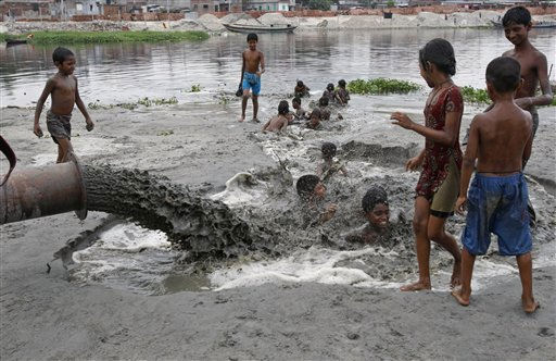 "<div class=""meta image-caption""><div class=""origin-logo origin-image ""><span></span></div><span class=""caption-text"">Bangladeshi children play in polluted water that is pumped into the river Buriganga in Dhaka, Bangladesh, Sunday, June 5, 2011.  World Environment Day is celebrated June 5 every year by the United Nations to stimulate worldwide awareness of environmental issues and encourages political action. (AP Photo/ Pavel Rahman) (AP Photo/ Pavel Rahman)</span></div>"