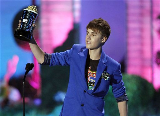 Justin Bieber accepts the award for best jaw dropping moment at the MTV Movie Awards on Sunday, June 5, 2011, in Los Angeles. &#40;AP Photo&#47;Matt Sayles&#41; <span class=meta>(AP Photo&#47; Matt Sayles)</span>