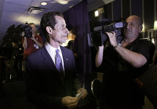 "<div class=""meta image-caption""><div class=""origin-logo origin-image ""><span></span></div><span class=""caption-text"">U.S. Congressman Anthony Weiner, D-NY, is pursued by the media as he leaves a news conference in New York,  Monday, June 6, 2011. After days of denials, a choked-up New York Democratic Rep. Anthony Weiner confessed Monday that he tweeted a bulging-underpants photo of himself to a young woman and admitted to ""inappropriate"" exchanges with six women before and after getting married. (AP Photo/Richard Drew) (AP Photo/ Richard Drew)</span></div>"