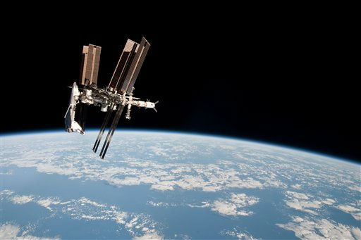 This May 23, 2011 photo made by Expedition 27 crew member Paolo Nespoli from the Soyuz TMA-20 following its undocking and released by NASA shows the International Space Station and the docked space shuttle Endeavour, left, at an altitude of approximately 220 miles. A Soyuz capsule had never headed for home while a shuttle was parked at the space station, providing a rare opportunity for the photo session. &#40;AP Photo&#47;NASA, Paolo Nespoli&#41; <span class=meta>(AP Photo&#47; Paolo Nespoli)</span>
