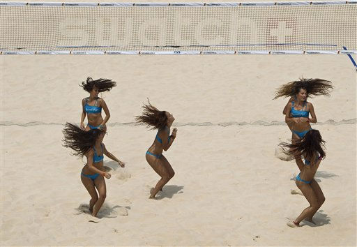 Cheerleaders from Spain perform during the Swatch World Tour Beach Volley Ball competition at Chaoyang Park in Beijing, China Tuesday, June 7, 2011. &#40;AP Photo&#47;Andy Wong&#41; <span class=meta>(AP Photo&#47; Andy Wong)</span>