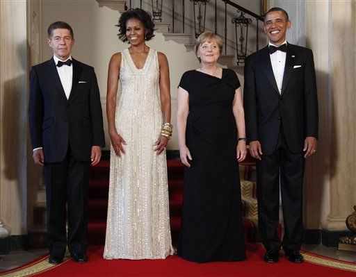 "<div class=""meta image-caption""><div class=""origin-logo origin-image ""><span></span></div><span class=""caption-text"">First lady Michelle Obama and President Barack Obama with German Chancellor Angela Merkel and her husband Joachim Sauer pose at the Grand Staircase as they arrive for a State Dinner at the White House in Washington, Tuesday, June 7, 2011. (AP Photo/Pablo Martinez Monsivais), (AP Photo/ Pablo Martinez Monsivais)</span></div>"
