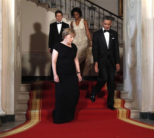 "<div class=""meta image-caption""><div class=""origin-logo origin-image ""><span></span></div><span class=""caption-text"">First lady Michelle Obama and President Barack Obama with with German Chancellor Angela Merkel and her husband Joachim Sauer at the Grand Staircase as they arrive for a State Dinner at the White House in Washington, Tuesday, June 7, 2011. (AP Photo/Pablo Martinez Monsivais) (AP Photo/ Pablo Martinez Monsivais)</span></div>"
