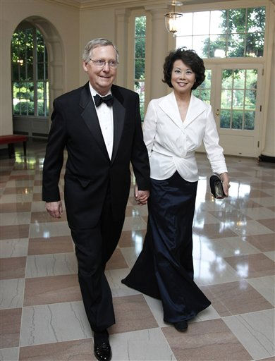 "<div class=""meta image-caption""><div class=""origin-logo origin-image ""><span></span></div><span class=""caption-text"">Senate Republican Leader Sen. Mitch McConnell, R-Ky., and his wife former Labor Secretary Elaine Chao, arrive for a State Dinner hosted by President Barack Obama and first lady Michelle Obama in honor of German Chancellor Angela Merkel at the White House in Washington, Tuesday, June 7, 2011.  (AP Photo/Manuel Balce Ceneta) (AP Photo/ Manuel Balce Ceneta)</span></div>"
