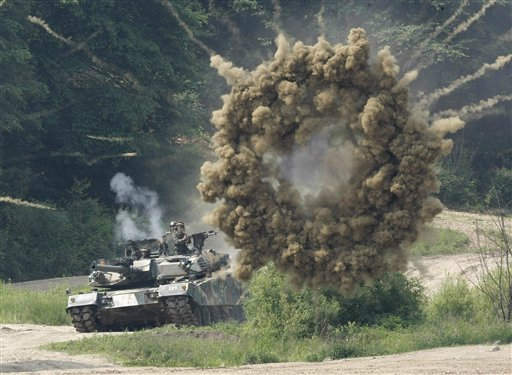 A smoke bomb explodes near a South Korean army K-1 tank during a South Korea and U.S. joint military exercise against possible North Korean attacks in Paju near the demilitarized zone &#40;DMZ&#41; between the two Koreas, on Wednesday, June 8, 2011. North Korea conducted a routine short-range missile test last week in an apparent effort to improve its missile capabilities, a South Korean official said Wednesday, amid renewed tension on the Korean peninsula. &#40;AP Photo&#47;Ahn Young-joon&#41; <span class=meta>(AP Photo&#47; Ahn Young-joon)</span>