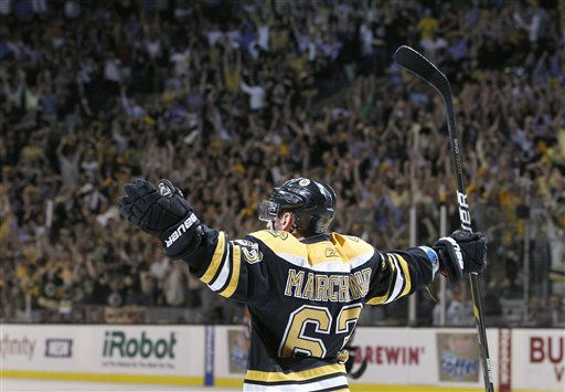 "<div class=""meta image-caption""><div class=""origin-logo origin-image ""><span></span></div><span class=""caption-text"">Boston Bruins left wing Brad Marchand (63) reacts after scoring a goal against the Vancouver Canucks during Game 4 of the NHL hockey Stanley Cup finals, Wednesday, June 8, 2011, in Boston. (AP Photo/Elise Amendola) (AP Photo/ Elise Amendola)</span></div>"