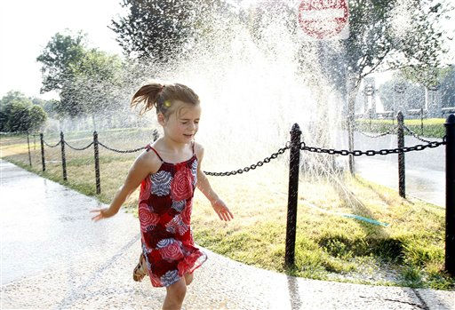 Allie Marsinko, 5, of Connellsville Pa., cools off from the simmering heat running through a water sprinkler at the National Mall in Washington, Wednesday, June 8, 2011.  &#40;AP Photo&#47;Manuel Balce Ceneta&#41; <span class=meta>(AP Photo&#47; Manuel Balce Ceneta)</span>