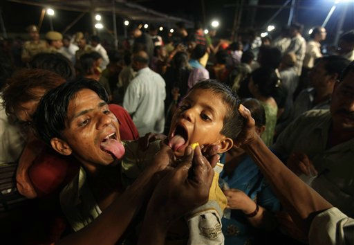In this Wednesday, June 8, 2011 photo, a boy sticks out his tongue to swallow live sardines smeared with secret herbs, believed to be a cure for asthma, in Hyderabad, India. People travel every June from across India to Hyderabad for the treatment offered free by one family on a day chosen by astrologers. The Goud family says it received the secret formula from a Hindu saint about 170 years ago, but refuse doctors&#39; requests for the herbal mix, saying the saint warned it would lose its potency if commercialized. &#40;AP Photo&#47;Mahesh Kumar A.&#41; <span class=meta>(AP Photo&#47; Mahesh Kumar A)</span>