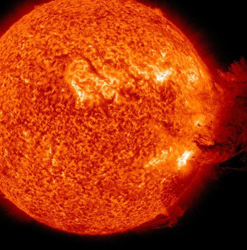 This image provided by NASA shows the Sun unleashing a medium-sized solar flare, a minor radiation storm and a spectacular coronal mass ejection on June 7, 2011. The large cloud of particles mushroomed up and fell back down looking as if it covered an area of almost half the solar surface. The ejection should deliver a glancing blow to Earth&#39;s magnetic field during the late hours of June 8th or June 9th. High-latitude sky watchers should be alert for auroras when the CME arrives. &#40;AP Photo&#47;NASA&#41; <span class=meta>(AP Photo&#47; Anonymous)</span>