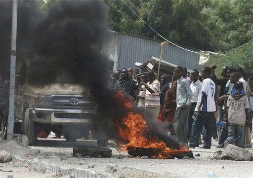 "<div class=""meta image-caption""><div class=""origin-logo origin-image ""><span></span></div><span class=""caption-text"">Protestors loyal to Somalia Prime Minister Mohamed Abdullahi Mohamed burn tyres in front of a checkpoint at the gates of the Mogadishu presidential palace during violent rallies in Mogadishu, Somalia, on Thursday June 9, 2011.  A deal has been reached between President Sheik Sharif Sheik Ahmed and Speaker Sharif Hassan Sheik Aden, calling for calls for Prime Minister Mohamed Abdullahi Mohamed to resign within 30 days and for the postponement of upcoming presidential elections by one year to help the government deal with security and political issues. (AP Photo/Farah Abdi Warsameh) (AP Photo/ Farah Abdi Warsameh)</span></div>"